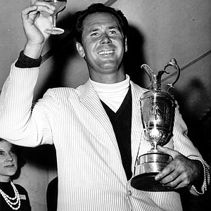 Tony Lema of San Leandro, Ca. holds a glass of champagne and his trophy after winning the British Open Golf Championship at St. Andrews, Scotland on July 10, 1964.