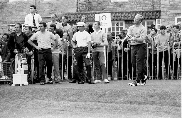 Jack Nicklaus, Columbus, Ohio, drives at the 10th hole in practice for the British Open Championship at Muirfield, Edinburgh, Scotland, on July 10, 1966. Nicklaus teams with South Africa's Gary Player, left.