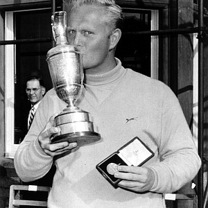 American golfer Jack Nicklaus kisses the victory cup and holds his medal after winning the British Open Golf Championship at Muirfield, Edinburgh, Scotland, June 9, 1966.