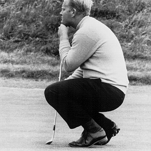 Jack Nicklaus lines up a putt at the green at Muirfield in Edinburgh, Scotland, during the final practice round before the start of the British Open Golf Championship, July 5, 1966.