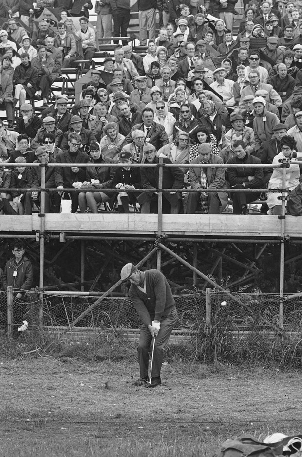 Arnold Palmer of Latrobe, Pa., Chips from rough in front of spectators stand onto third green in final round of British open Golf championship at Carnoustie, Scotland, on July 13, 1968.