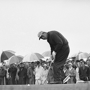 Arnold Palmer putts at the third hole of the British Open Golf Championship, July 12, 1968, Carnoustie, Scotland.