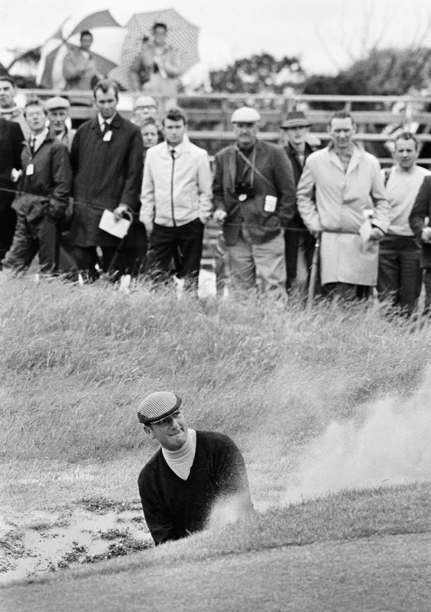 Argentina's Robert De Vicenzo watches his shot from the bunker at the second hole stop near the pin during the first round of the British Open Golf Championship at Lytham in St. Annes, England on July 9, 1969. The 46-year-old De Vicenzo won the Open in 1967.