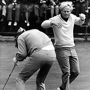 Doug Sanders, left, ducks as the putter thrown high in the air by Jack Nicklaus, right, comes down to narrowly missing him, during the British Open Golf tournament at St. Andrews, Scotland, July 7, 1970.