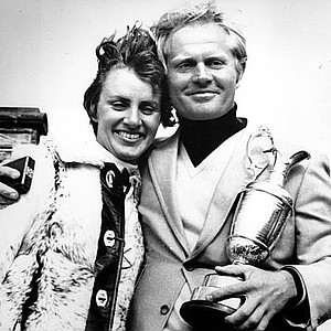 Jack Nicklaus, holding his trophy, hugs his wife Barbara after winning the 1970 British Open.
