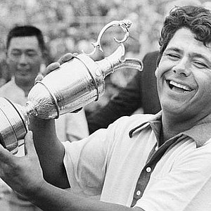 Lee Trevino shows off his trophy at the 1971 British Open at the Royal Birkdale in Southport, Eng. Trevino also won the American and Canadian open championships, establishing a golfing record by winning all three titles in the same year. In the background is second place finisher Liang Huan Lu, of Formosa.
