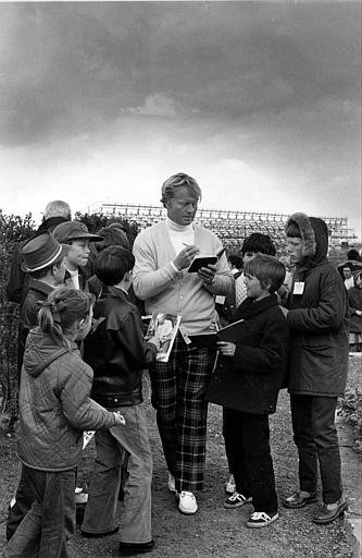 Jack Nicklaus signs autographs for young fans before going on practice round of the 1972 British Open in Muirfield Golf Course, Scotland. Nicklaus was trying for a Grand Slam after already winning the U.S. Masters and Open titles in 1972.