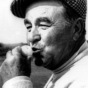 Gene Sarazen kisses his ball after a hole-in-one at the opening round of the 1973 British Open in Troon, Scotland.