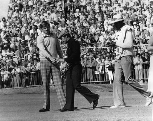 Gary Player, center, and Peter Oosterhuis shake hands after the final of the British Open at Royal Lytham and St. Anne's in Lancashire, England, July 13, 1974. Oosterhuis finished four strokes behind Player, 286, who won the British Open for the third time.