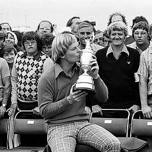 Johnny Miller kisses the British Open trophy after winning the title by six strokes at the Royal Birkdale golf course in Southport, England, July 10, 1976.