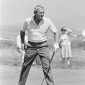 Arnold Palmer appears to be urging the ball on during the first round of the 1977 British Open at Ailsa Golf Course near Turnberry, Scotland. Palmer had just made a put on the fourth hole.