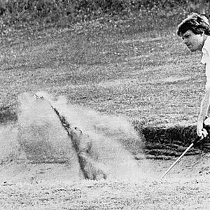 Tom Watson blasts out of bunker on Ailsa Course in third round of the 1977 British Open at Turnberry, Scotland.