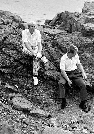 Jack Nicklaus, left, and Tom Watson sit on rocks on the beach below the 9th green when play in the 1977 British Open is stopped for a time when a sudden storm hit the Ailsa Course in Turnberry, Scotland. Watson went on to win the title with a score of 268.