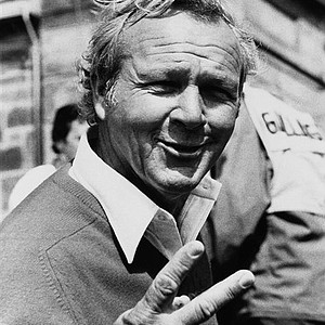 Arnold Palmer holds up two fingers as he comes in at the end of play in the 1978 British Open at St. Andrews, Scotland. Palmer was 6 under par at one time; he took seven strokes at the 17th hole, and birdied the 18th to stay in contention.