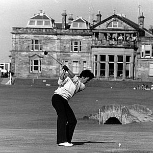 Isao Aoki, of Japan, drives from the 18th tee toward the Royal and Ancient Club House at the 18th green in Friday's play in the 1978 British Open at St. Andrews, Scotland.