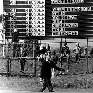 Tom Watson walks past the scoreboard during his play in the 1978 British Open at St. Andrews, Scotland. The scoreboard shows Watson leading the field at this stage. He finished level with Peter Oosterhuis, Great Britain, as joint leaders five under par.