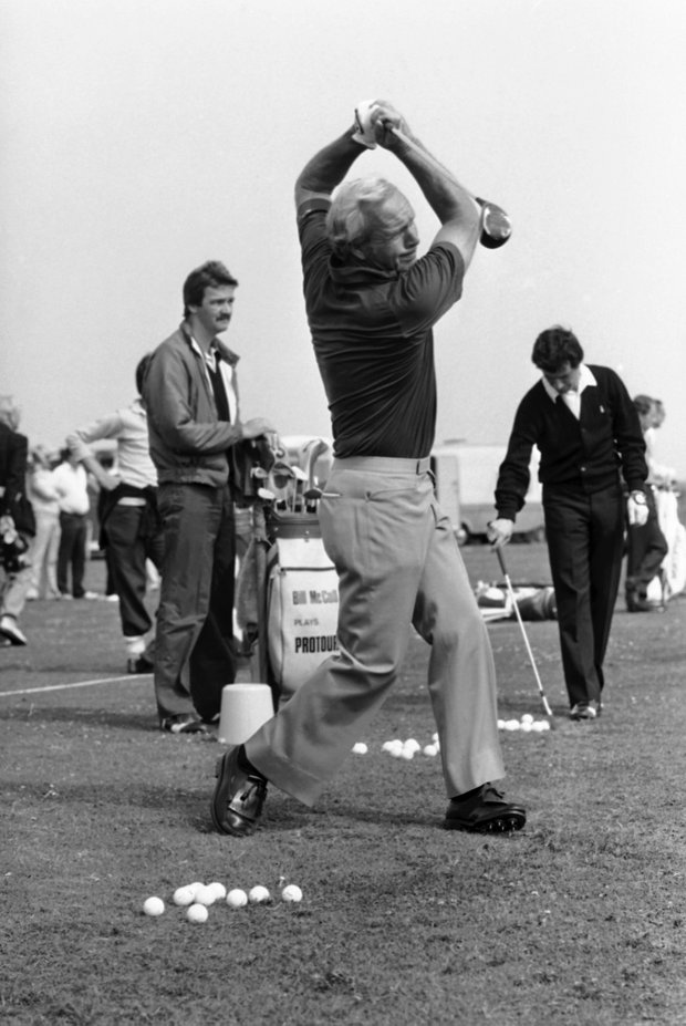 Arnold Palmer, center, drives off from the 1st tee during practice for the British Open Golf Championship, July 15, 1981, Sandwich, England.