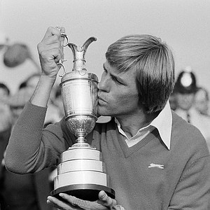 Golfer Bill Rogers kisses his winner's trophy after the British Open Golf Championship, July 18, 1981, in Sandwich, England.
