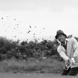 Arnold Palmer blasts out of a trap on the first hole of the first round of the British Open Golf Tournament, Thursday, July 15, 1982, Troon, Scotland.