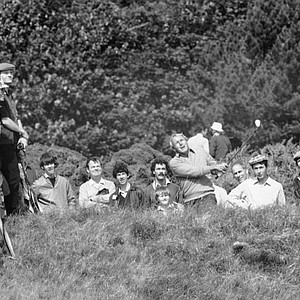 Arnold Palmer, center, hits out of the rough on the 13th fairway during British Open Golf Championship play, July 17, 1982, Troon, Scotland.