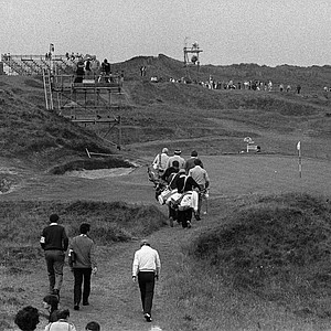 "This is the eighth hole of the Royal Troon Golf Club, known as the ""Postage Stamp"" hole, shown in 1982. The British Open is famous for this hole as well as for producing American winners."