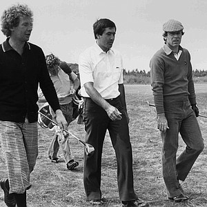 Australian Stuart Ginn, left, Spain's Severiano Ballesteros, centre, and Australian Graham Marsh walk around the course at Muirfield, Scotland, on July 16, 1984, in preparation for the start of the British Open.