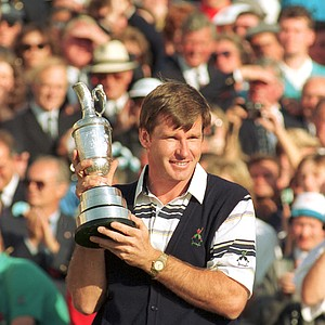 Nick Faldo, of Wentworth England, holds his trophy following his victory of the 119th British Open Golf Championship at St. Andrews, Scotland, Sunday, July 22, 1990.