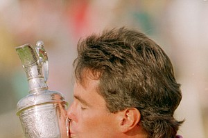 Australia's Ian Baker-Finch gives his British Open Championship trophy a kiss after winning the 120th Open Championship at Royal Birkdale, England, Sunday, July 21, 1991.