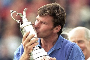 Britain's Nick Faldo kisses the British Open golf championship trophy he won at Muirfield in Scotland, July 19, 1992.