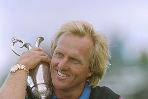 Australia's Greg Norman hugs the trophy after winning the British Open Golf Championship, Sunday, July 18, 1993 at Royal St. Georges golf club, Sandwich, England. Norman came back -- all the way back, beating old nemesis Nick Faldo with a record score and acquiring his second British Open golf championship.