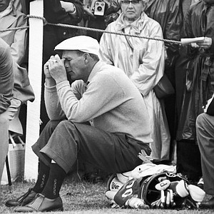 Arnold Palmer, U.S. Open champion, sits on his golf bag and relaxes halfway through his troublesome second round of qualifying play, July 5, 1960 in the British Open championship at St. Andrews, Scotland.