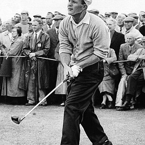 Arnold Palmer of Latrobe, Pa., U.S. open and masters champion, twists body as he watches drive from 10th tee in second round of British Open golf tourney at St. Andrews, Scotland on July 7, 1960.