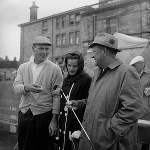 "Arnold Palmer, left, U.S. Open and Masters champion, chats with his wife Winnie and father, Milford ""Deke"" Palmer at the first tee before starting second round play in the British Open Golf Tourney at St. Andrews, Scotland, July 7, 1960."