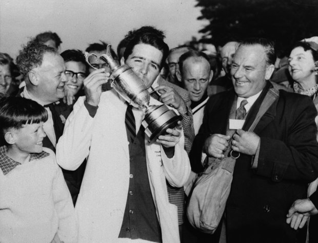 Gary Player, 23-year-old South African, is shown kissing the winner's trophy that his 72-hole total of 284 got him at Muirfield, Scotland, July 3, 1959.