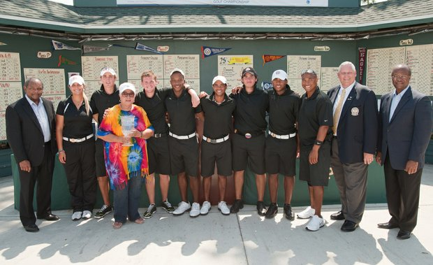 From left, Eddie Brown, president and CEO of Brown Capital Management, with the Bethune-Cookman team: graduate assistant coach Maria Garrido, freshman/medalist Matthew McKnight, Jean 'Momma Jean' Freeman (widow of former coach Gary Freeman), sophomore Alex Clapp, freshman JaMichael Jones, freshman Emmanuel Petrich, freshman Rafael Abad, freshman Jerrell Parrish and coach Loritz Clark, flanked by PGA officials Allen Wronowski and Earnie Ellison at the PGA Minority Championship.