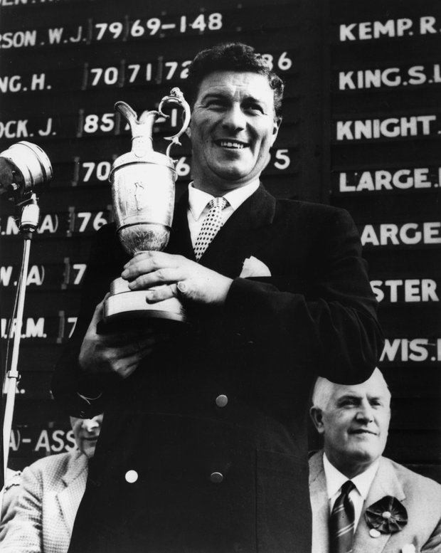 Peter Thomson, 28, of Australia, smiles as he holds the trophy after winning his fourth British Open  at Royal Lytham and St. Anne's in Lancashire, England, on July 5, 1958.