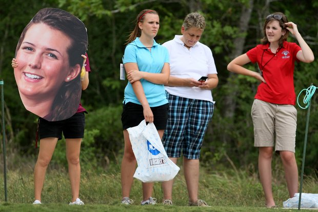 Some followers of Texas A&M players carried around large cardboard cut-outs of players, Katerina Ruzickova, shown here, during Round 1 of the Traditions Golf Club for the Women's Division I Golf Championships.