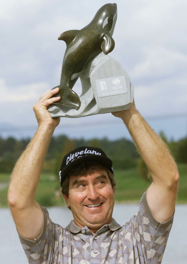 Gene Sauers hoists the trophy after winning the Air Canada Championship played at Northview Golf and Country Club in Surrey, British Columbia, Sunday, Sept.1, 2002. This is Sauers first win on the PGA Tour since 1989.