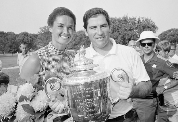 Dave Stockton of Westlake, Calif., and his wife, Cathy, hold the PGA Championship trophy after Stockton won the 72-hole tournament with a 1-under 279 at Southern Hills Country Club in Tulsa, Okla., Aug. 16, 1970.