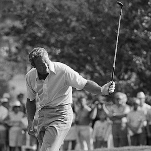 Palmer fails in Birdie try-p. Arnold Palmer does a little dance on the 14 green on Feb. 25, 1971 in Palm Beach Gardens, as he barely misses a birdie on the par 4 hole in the first round of the PGA Championship.