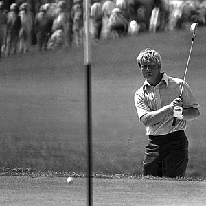 Tight-lipped Jack Nicklaus watches a chip shot roll onto the 18th green just short of the hole in the first round of the PGA Championship at Palm Beach Gardens, Fl., Feb. 25, 1971.