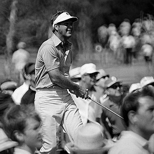 "Arnold Palmer with ""Arnie's Army"" surrounding him drive on No. 5 hole in the third round of the PGA Championship on Feb. 27, 1971 in Palm Beach Gardens."