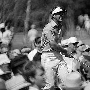 """Arnold Palmer with """"Arnie's Army"""" surrounding him drive on No. 5 hole in the third round of the PGA Championship on Feb. 27, 1971 in Palm Beach Gardens."""