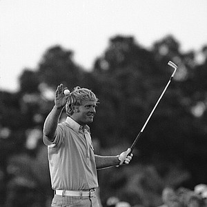 Jack Nicklaus smiles and holds up his club after winning the PGA Championship, 7 under par, at Palm Beach Gardens, Fla., Feb. 28, 1971.
