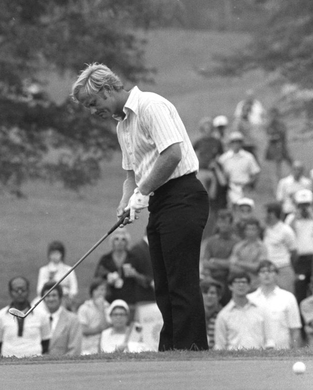 Jack Nicklaus looks down at his hands after he was short with his chip onto the 18th green on Aug. 4, 1972, from the first round of play in the PGA Championship tournament in Birmingham.