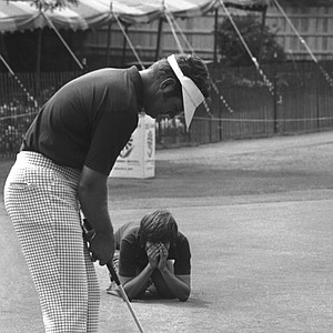 Gene Borek, playing out of East Norwich, New York gets help from his caddy, Anthony Kiely, on practice green, Wednesday, August 8, 1973 in Cleveland during warmup for the start of the 55th PGA Championship at Cleveland's Canterbury Golf Club.