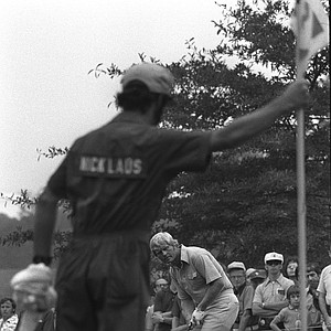 Framed by his caddy and the pin, Jack Nicklaus misses a birdie attempt on the third green during the second round of the PGA Championship, Aug. 10, 1973, in Cleveland, Ohio.