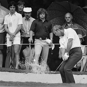 Arnold Palmer, who has never won the PGA Championship, hits out of a sand trap on the fourth hole, Aug. 8, 1974, during the first round of the PGA in Clemmons, N.C.