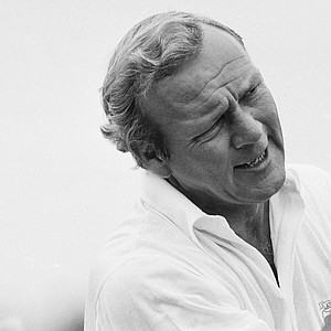 Legendary Arnold Palmer studies his shot while warming up for the final round of the PGA Championship on Sunday, August 11, 1974 in Clemmons, N.C.