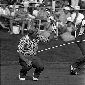 With putter raised, Jack Nicklaus sinks to the 16th green as his 30-foot putt drops in the hole for par in the third round of the PGA Championship in Akron, Ohio, Aug. 9, 1975